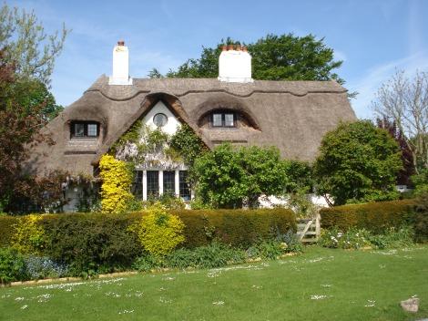 Eines der hübschen Cottages am Village Green. Eigenes Foto.