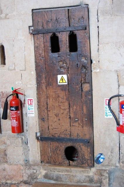 Die Tür unter der Uhr mit der Katzenklappe.  © Copyright Julian P Guffogg and licensed for reuse under this Creative Commons Licence.